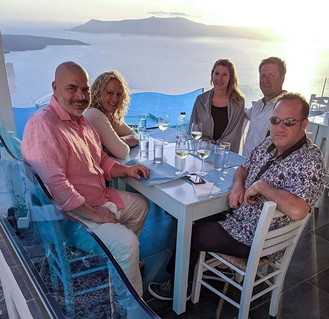 Dinner and cocktails with The Friends at the Volcano Blue restaurant in Fira, Santorini, Greece.